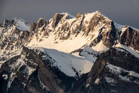 winter mountain landscape in the Swiss Alps in evening light