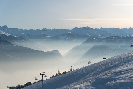 ski resort in the Alps with chair lift and ski slopes and a great view