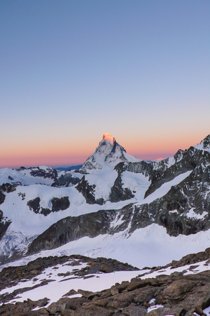 dawn and a new day begin over the famous Matterhorn peak in Switzerland
