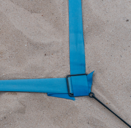 beach volleyball court up close and in detail with blue plastic line marker