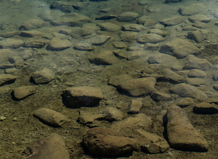 abstract background of rocks underwater in a calm mountain lake Фото со стока