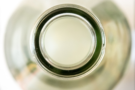 looking into a white transparent glass bottle from bove Stock Photo