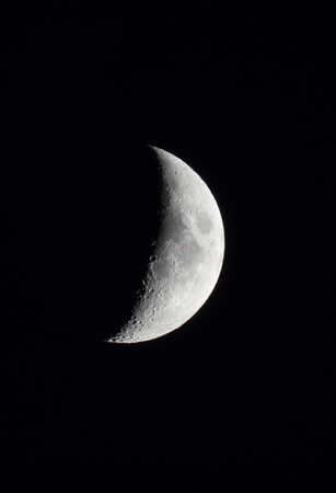 crescent moon in a black night sky 版權商用圖片