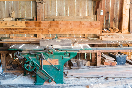 A view of the interior of an old traditional saw mill with old machines and tools