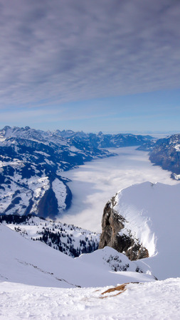 winter mountain landscape with a view of the Alps in southeastern Switzerland