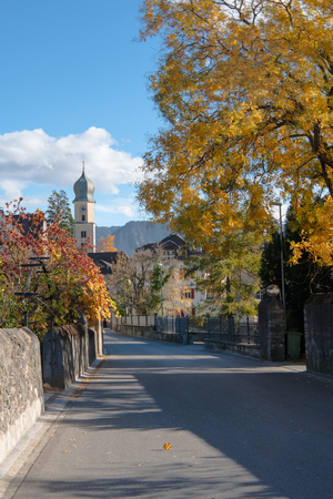 village center of the idyllic alpine town of Maienfeld in the Swiss Alps on a beautiful autumn day