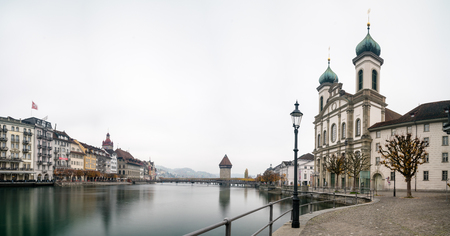 the famous Swiss city of Lucerne cityscape skyline and Kappel bridge with water tower panorama view long exposure Stock Photo