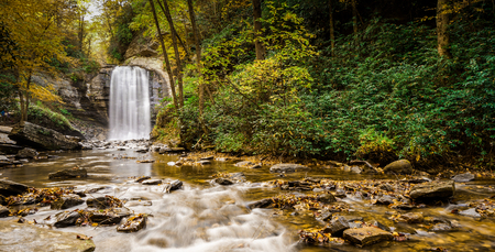 Looking Glass falls in the Appalachians of North Carolina in late autumn with fall color foliage Stock Photo
