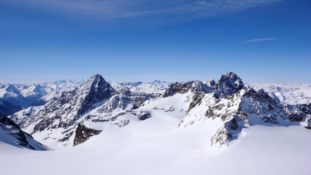 winter mountain landscape in the Alps of Switzerland with peaks and glaciers