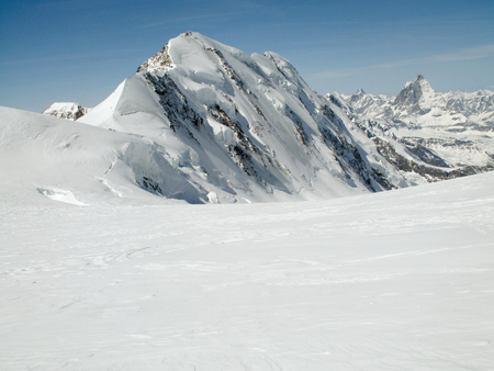 winter mountain landscape in the Swiss Alps with a detail view of the north face of Liskamm above Zermatt