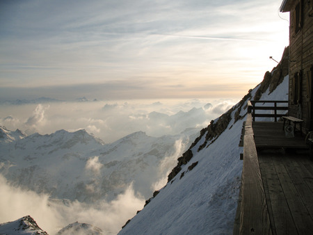 balcony of the mountain hut on top of Signalkuppe with a great view of the Alps around Zermatt in the Monte Rosa range in Switzerland