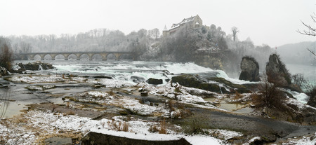 deep winter landscape at Rhine Falls in Schaffhausen in Switzerland with the castle at Laufen and a panorama view