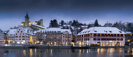 the river Rhine and the city of Schaffhausen in Switzerland with Munot castle at twilight in winter Stock Photo