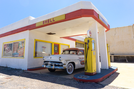 Lowell, AZ, USA  July 12. 2016: old fuel pump and classic car at an abandoned ghost town gas station near Bisbee in the Arizona desert