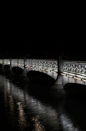 old stone bridge over the river in Zurich at night Imagens