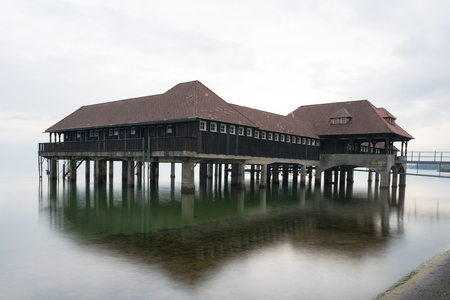 historic wooden building and bathhouse on Lake Constance in the town of Rorschach in Switzerland Stock Photo