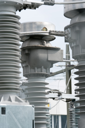 A detail view of transformers and conduits at an electric power station Archivio Fotografico