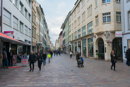 Winterthur, ZH / Switzerland - April 8, 2019: the hustle and bustle of the historic Marktgasse street in old town Winterthur with people running errands and shopping