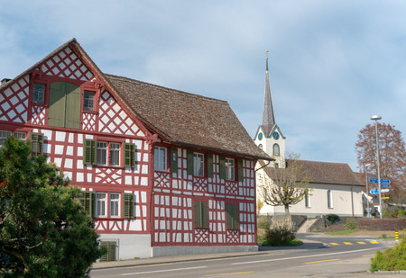 Guettingen, TG, Switzerland - 22 April 2019: traaffic circle intersection in Guettingen framed by historic half-timbered houses and church Stock Photo