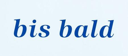 blue writing on white sign saying Stock fotó
