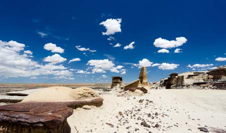 panorama rock desert landscape in northern New Mexico in the Bisti/De-Na-Zin Wilderness Area with washed out hoodoo rock formations under a blue sky Reklamní fotografie