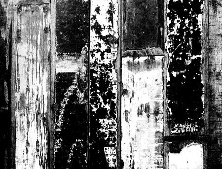bunte rustikale Holzdielen in verschiedenen Farben im Vintage-Stil als Hintergrund in kontrastreichem Schwarz-Weiß