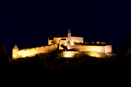 Gruyere, VD / Switzerland - 31 May 2019: the historic castle at Gruyere in the Swiss canton of Vaud at night
