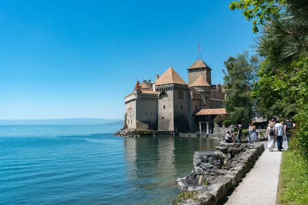 Montreux, VD / Switzerland - 31 May 2019: tourists visit the historic Chillon Castle on the shores of Lake Geneva