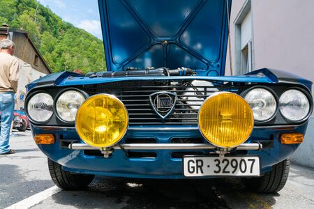 Bad Ragaz, SG  Switzerland - 23 June, 2019: grill and yellow rallye headlights of an old timer blue Lancia sportscar at the Heidiland Classic Car Meet