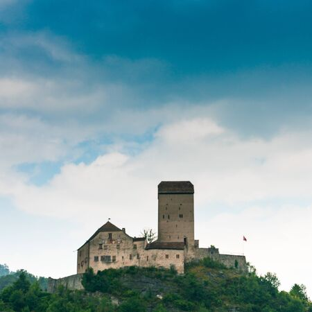 Sargans, SG / Switzerland - 9. July 2019: the historic medieval castle at Sargans in the southeastern Swiss Alps on its grassy hilltop promontory Sajtókép