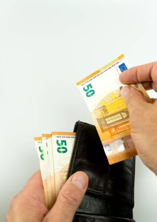 vertical isolated view of man offering 50 Euro cash as a bribe or payoff from a leather wallet