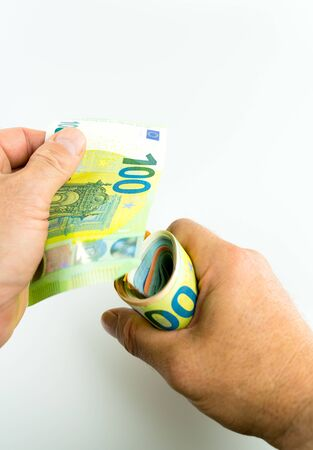 vertical isolated view of man offering 100 Euro cash as a bribe or payoff Stockfoto