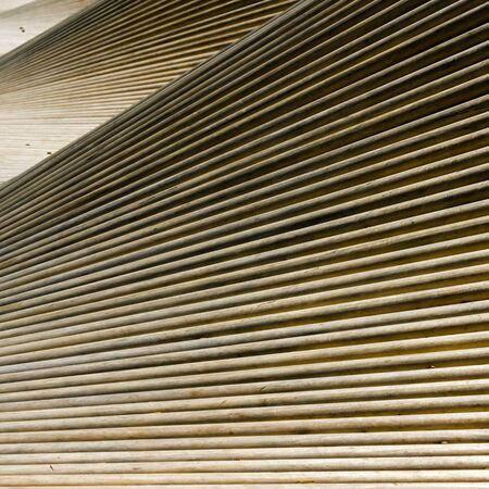 An abstract close up view of waves of wooden slats and planks as a background
