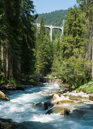 panorama view of the Langwies Viaduct in the mountains of Switzerland near Arosa with the Plessur river below