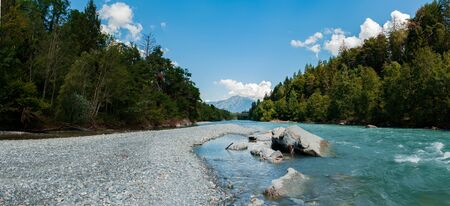 A panorama view of the picturesque Rhine River near its source in the Swiss Alps Stockfoto