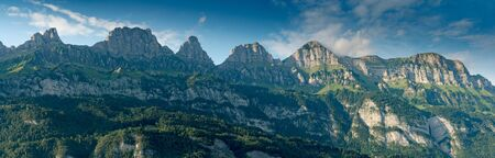 panorama view of the Churfirsten mountains in the Swiss Alps on a warm summer evening