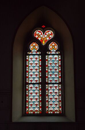 Rapperswil, SG  Switzerland - 3. August 2019: close up view of an ornate stained glass window in the Sankt Johann church in Rapperswil