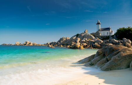 Horizontal view of the Pontusval lighthouse and bay on the north coast of Brittany in France Stock Photo