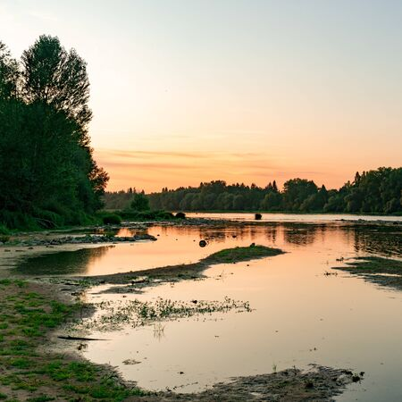 picturesque and calm summer evening sunset on the Loire River in France in square format
