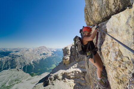 two female mountain climbers on very exposed Via Ferrata in Alta Badia in the Italian Dolomites Stock fotó