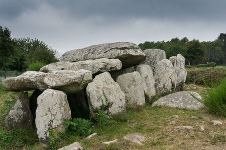 view of prehistoric monolith stone tomb or dolmen in Brittany at Carnac 写真素材