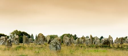 panorama view view of prehistoric monolith stone alignments in Brittany at Carnac at sunrise