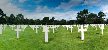 Omaha Beach, Normandy  France - 16 August 2019: panorama view of headstones in the American Cemetery at Omaha Beach in Normandy 写真素材