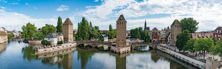 Strasbourg, Bas-Rhin  France - 10 August 2019: panorama view of the historic old town and canals of the city of Strassburg as seen from the Barrage Vauban Dam Redakční