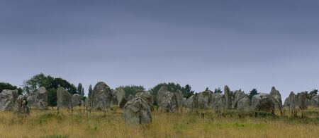 panorama view view of prehistoric monolith stone alignments in Brittany at Carnac at sunset