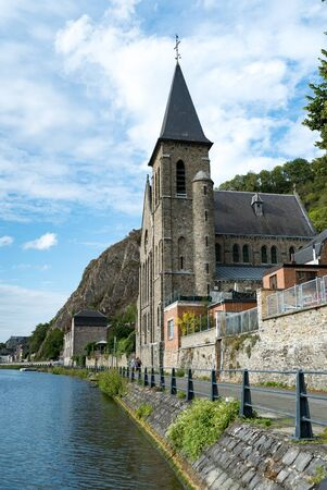 Dinant, Namur  Belgium - 11 August 2019: view of the Saint Paul-des-Rivages church and the river Meuse in Dinant
