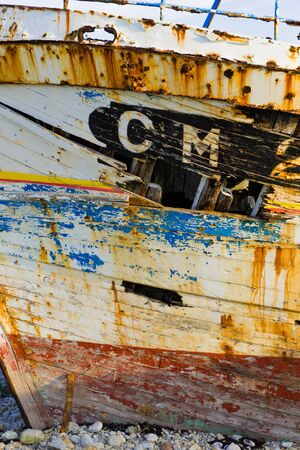 A close up view of a broken and cracked hull of an old wooden fishing boat Stock fotó