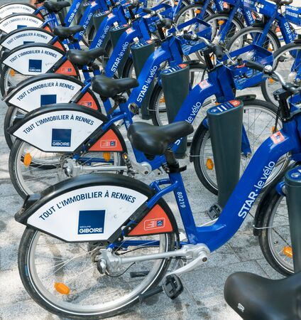 Rennes, Ille-et-Vilaine  France - 26 August 2019: bike rental station with many blue and white bikes in the city of Rennes in Brittany in France Redakční