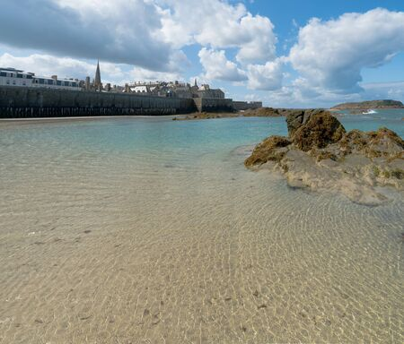 A view of the historic old town of Saint-Malo with beach and coast at low tide Redakční