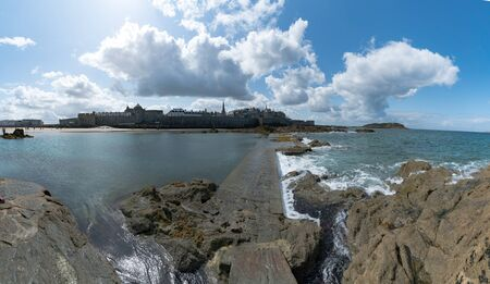 A view of the historic old town of Saint-Malo with beach and coast at low tide Stock fotó